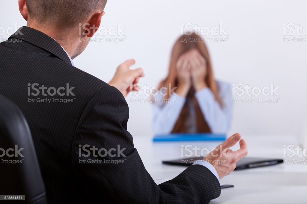Bullying on the job meeting stock photo