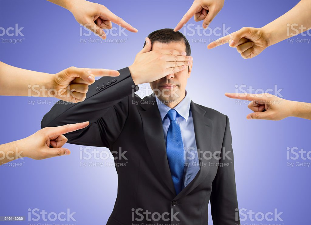 bullying to a business man stock photo