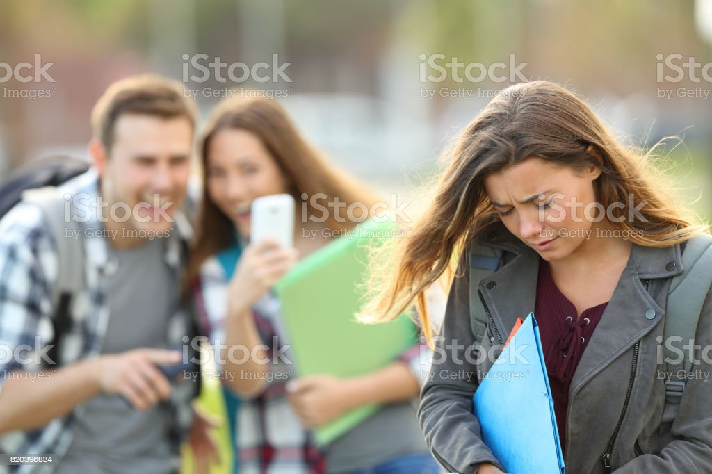 Bullying victim being recorded by classmates stock photo