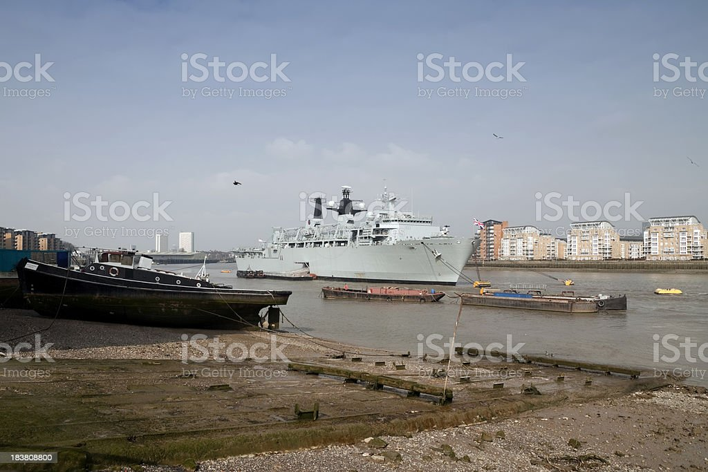 HMS Bulwark and old River Thames slipway stock photo
