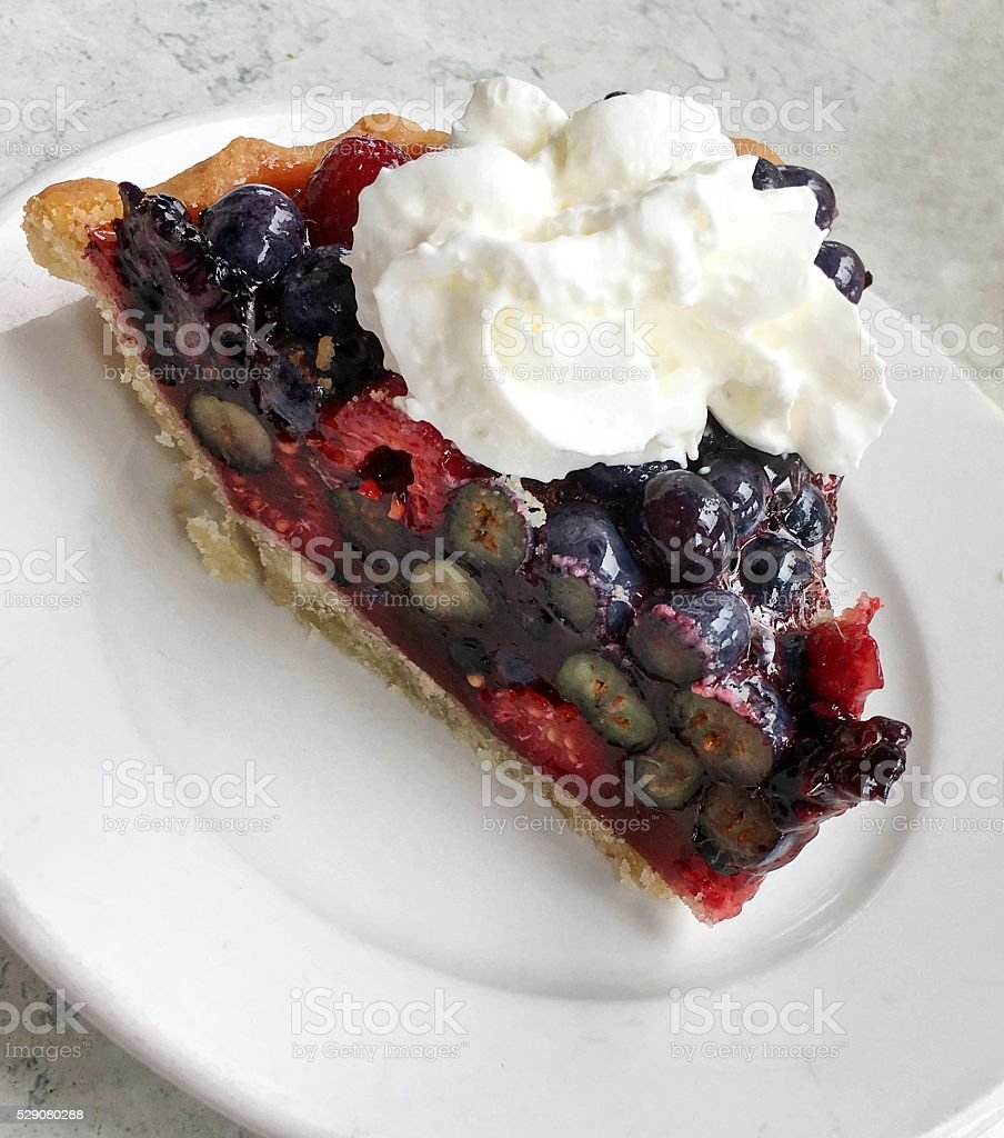 Bumbleberry pie with whipped cream stock photo
