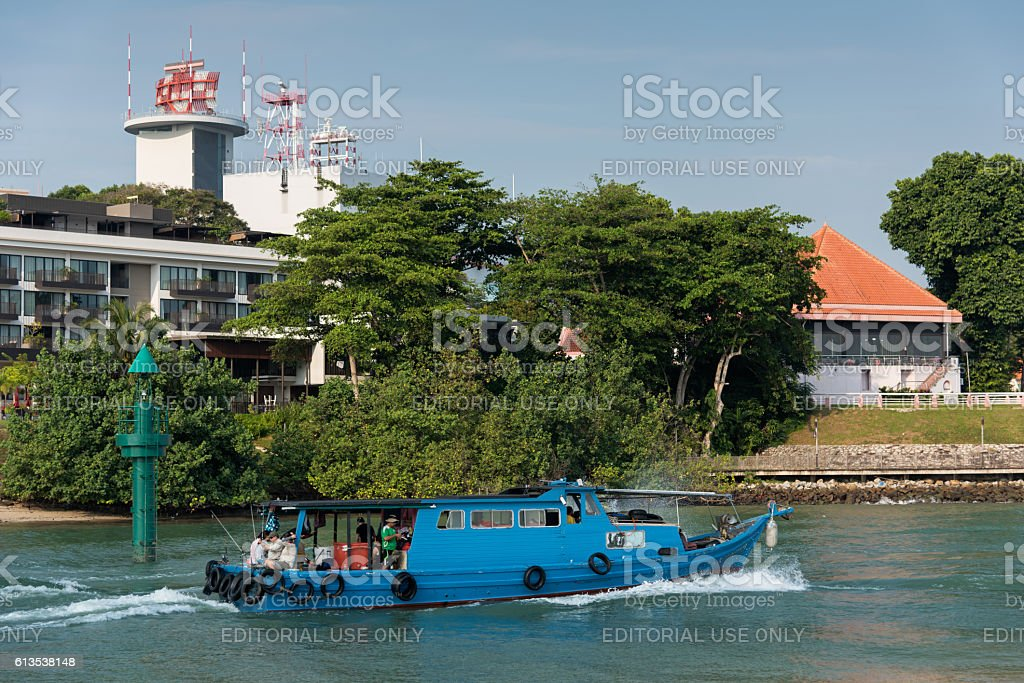 Bumboat passing by Changi Point stock photo