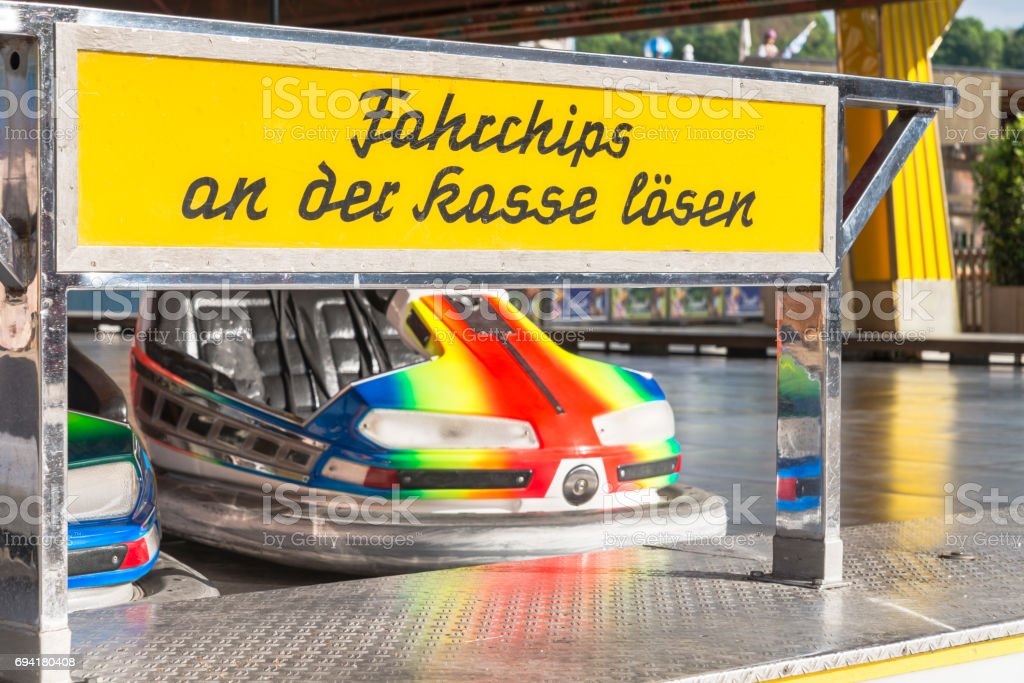 Bumper car  at a folk festival with german text that means buy tickets to ride at pay window stock photo