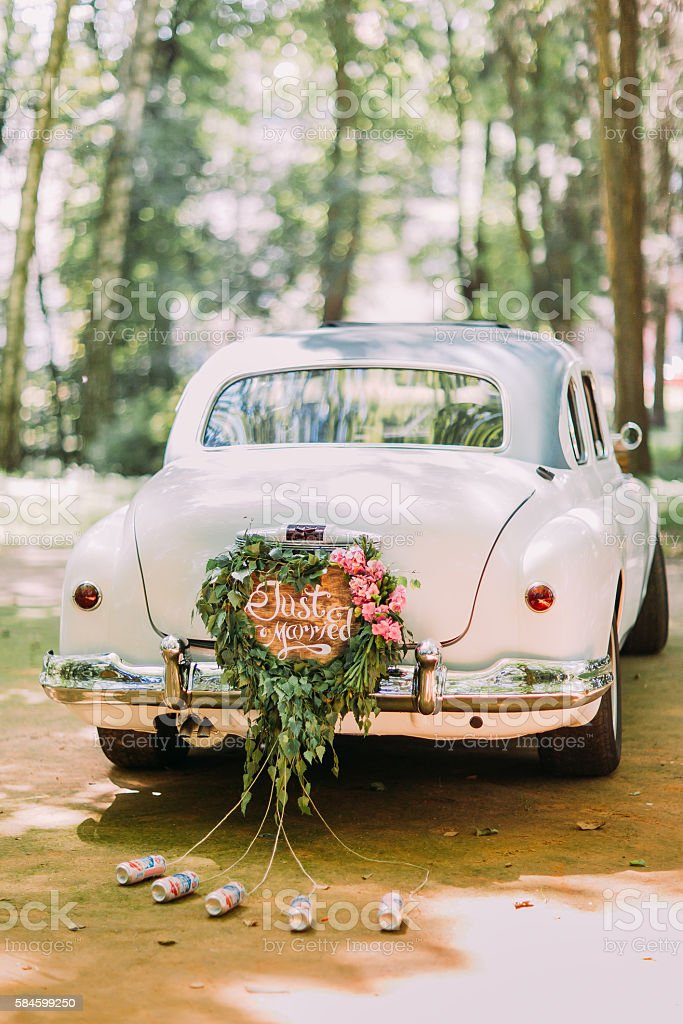 Bumper of retro car with just married sign and cans stock photo