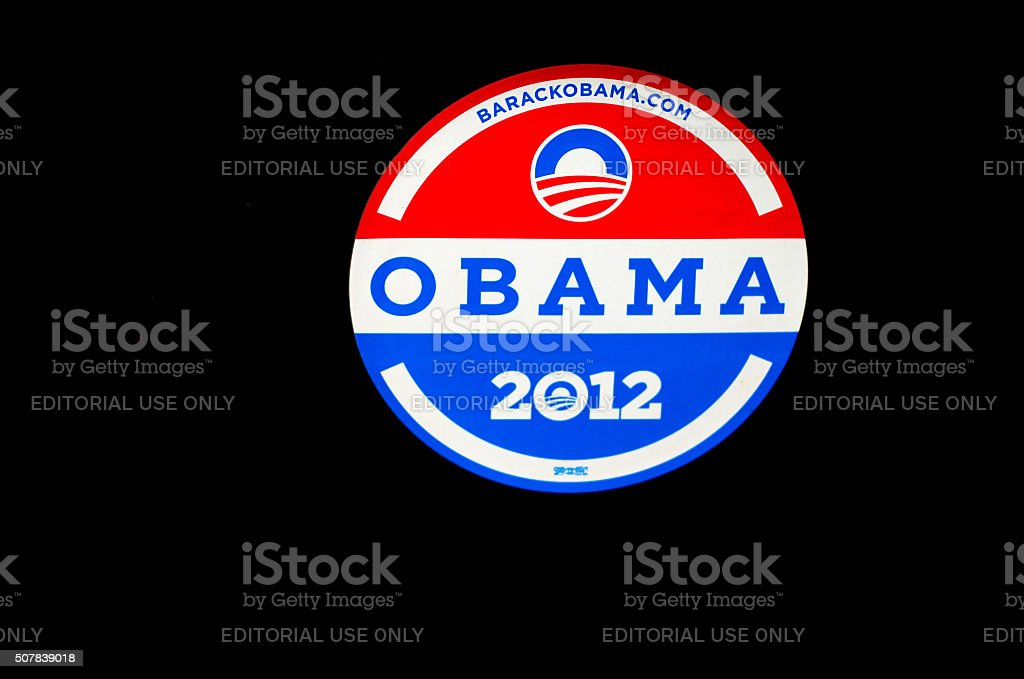 OBAMA 2012 Bumper Sticker on Black Car (Close-Up) stock photo