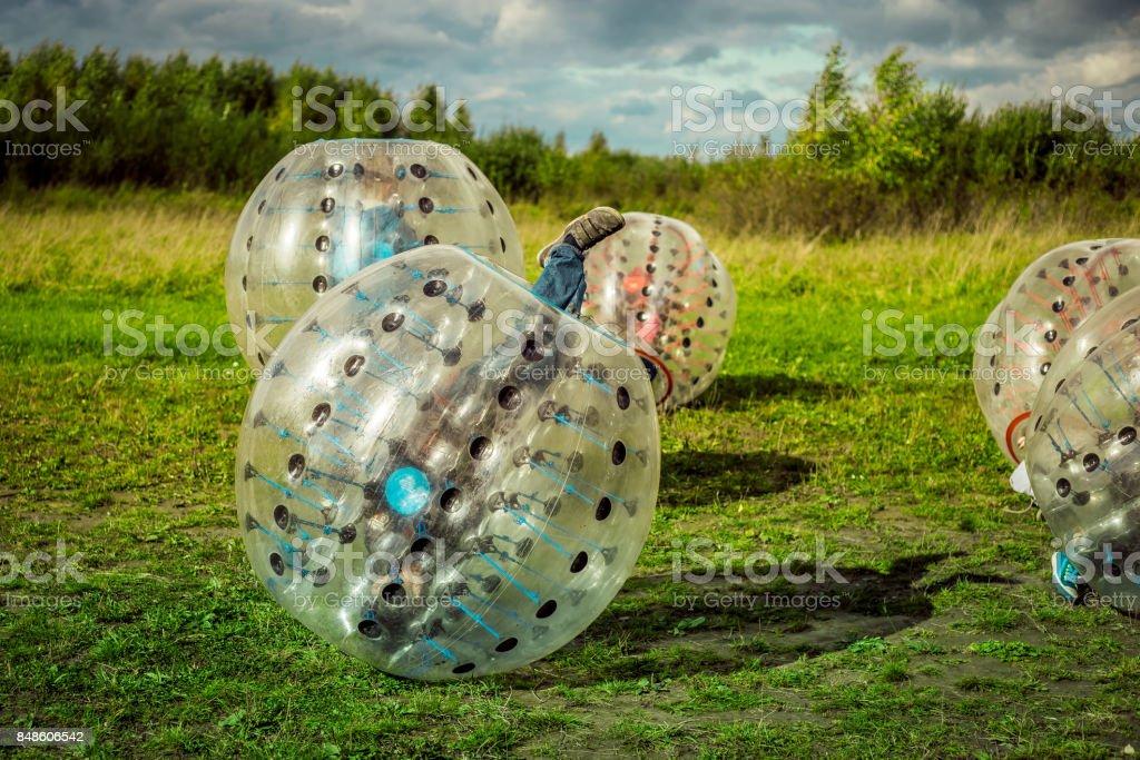 Bumperball. Teens play bumper-ball outdoor stock photo