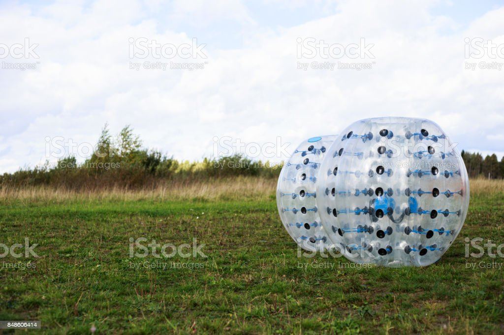 Bumper-balls for soccer playing on a green lawn, a new funsport stock photo