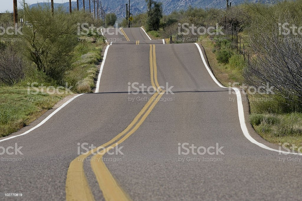 Bumpy Rural Road stock photo