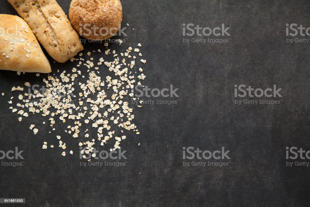 Bun of bread with oat flakes. stock photo