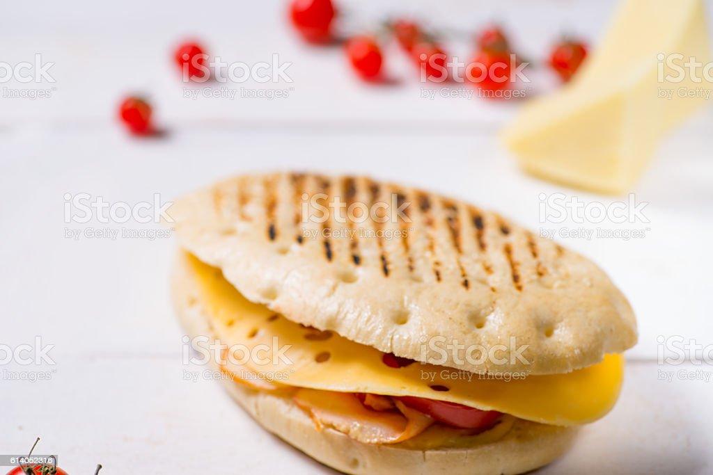 bun with cheese and ham stock photo