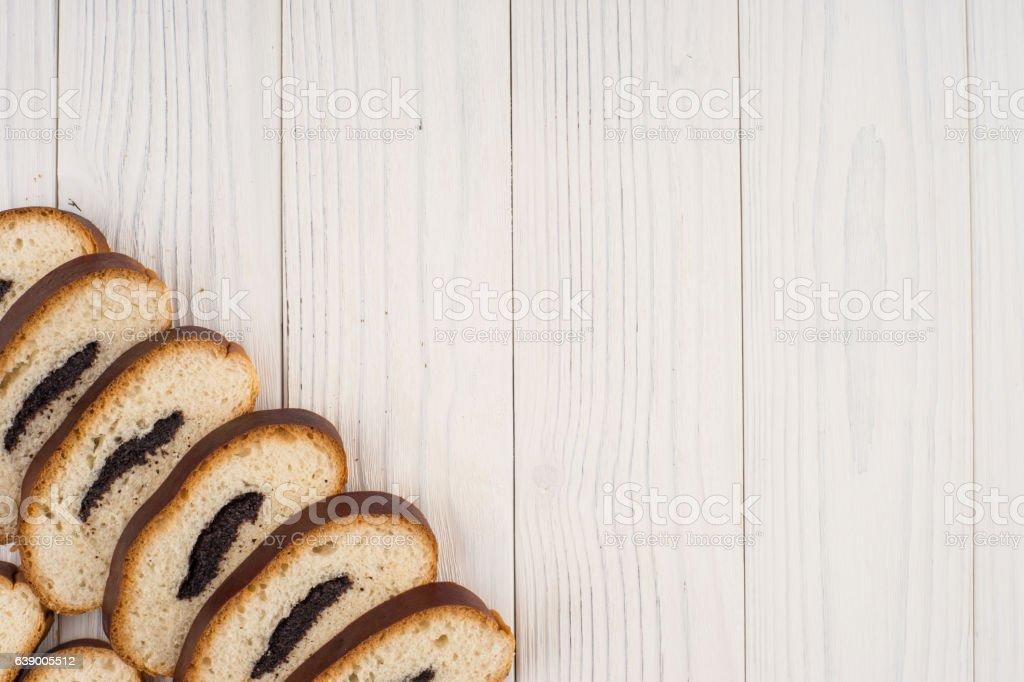 Bun with poppy seeds on a kitchen napkin stock photo