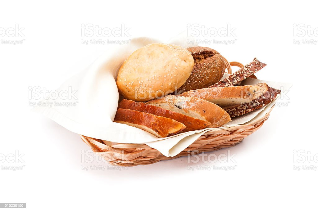 Bun with sesame, piece of of white and black bread. stock photo