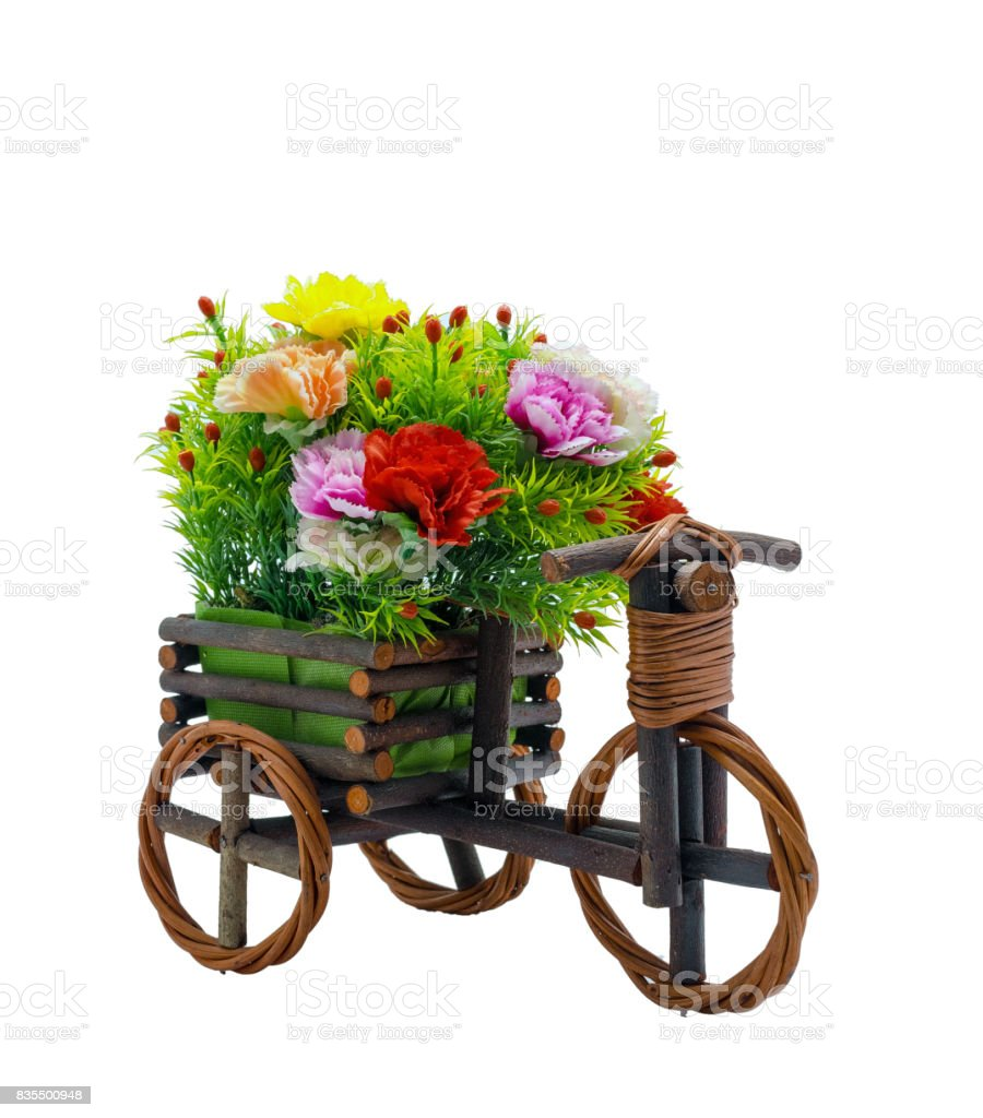 Bunch fake flowers in the wooden bicycle on white background, include clipping path stock photo
