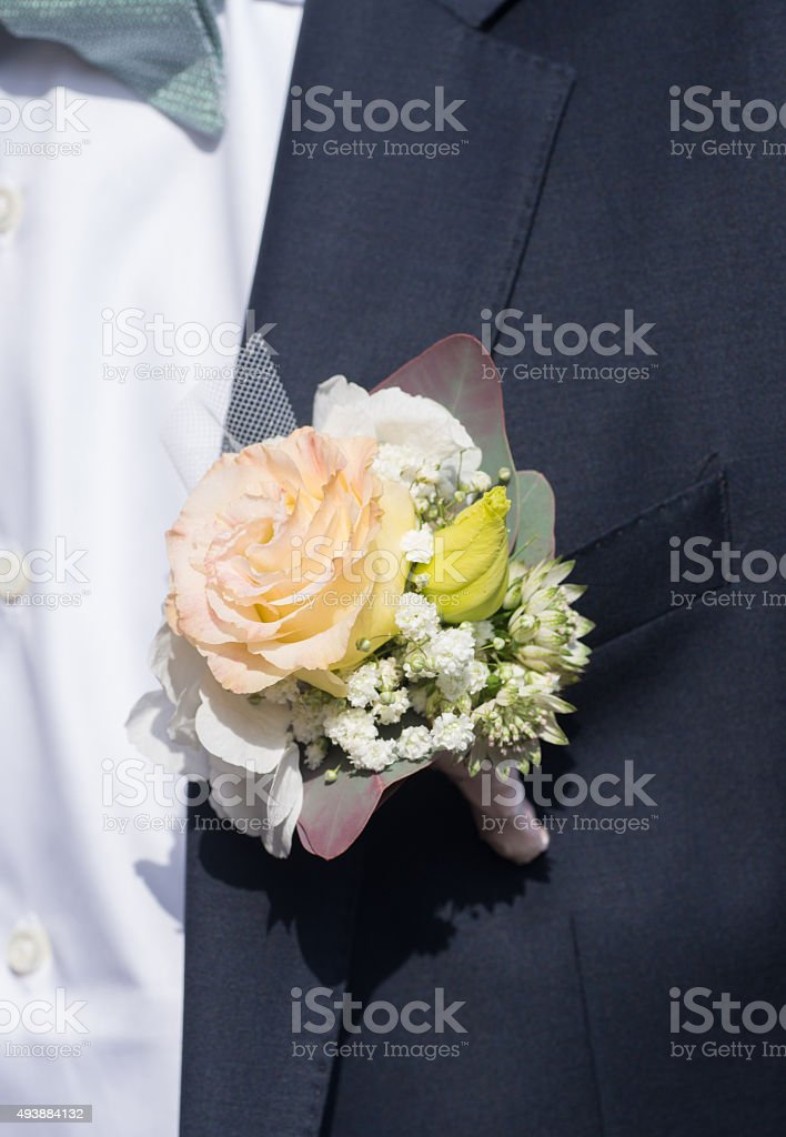bunch flowers on bridegroom suit stock photo