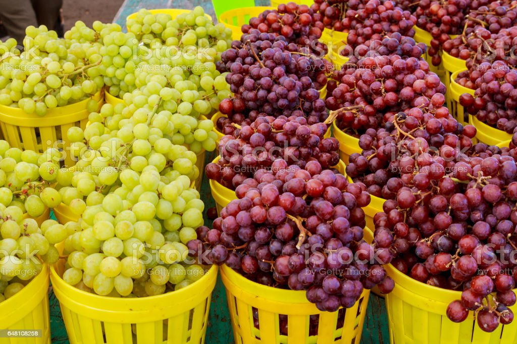 A Bunch Fresh Organic White And Red Grapes At A Street Market stock photo