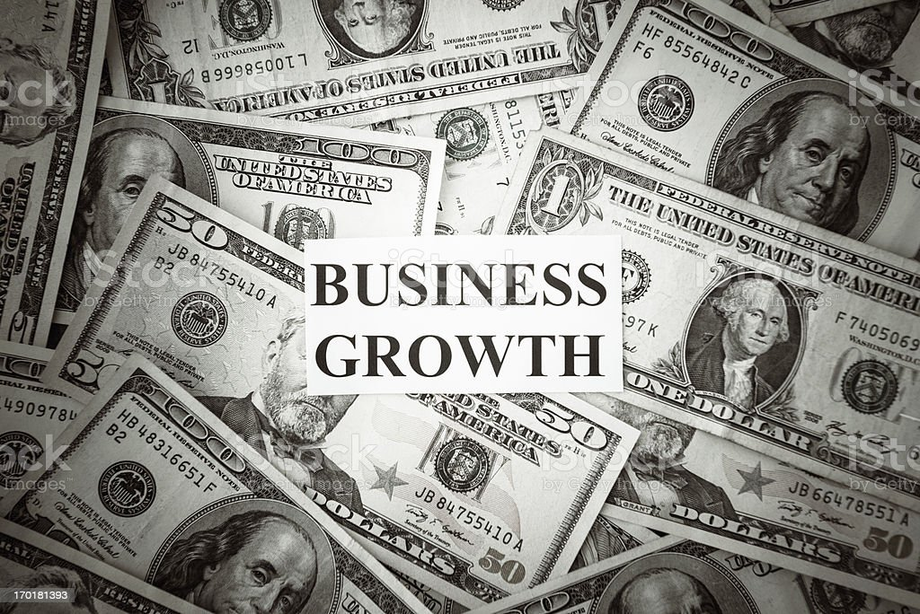 Bunch of American dollars with business growth text royalty-free stock photo