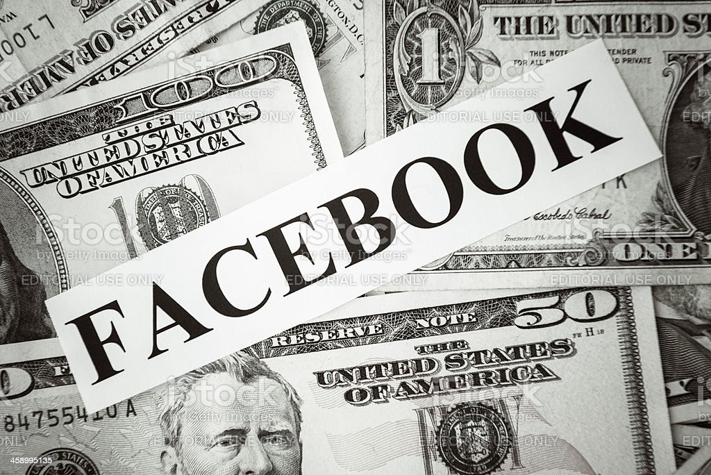 Bunch of American dollars with Facebbook social media website name royalty-free stock photo