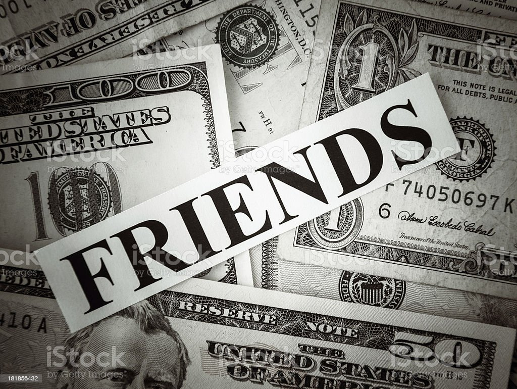 Bunch of American dollars with friends text royalty-free stock photo