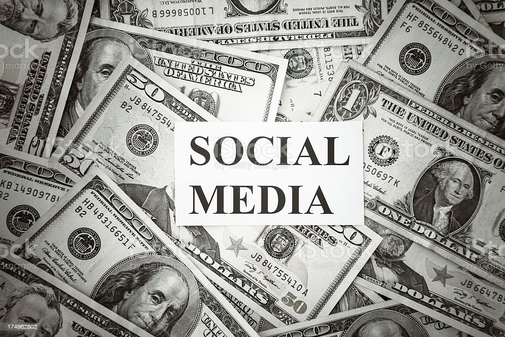 Bunch of American dollars with social media text royalty-free stock photo