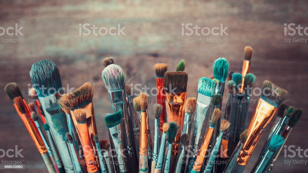 Bunch of artistic paintbrushes. Retro toned photo. stock photo