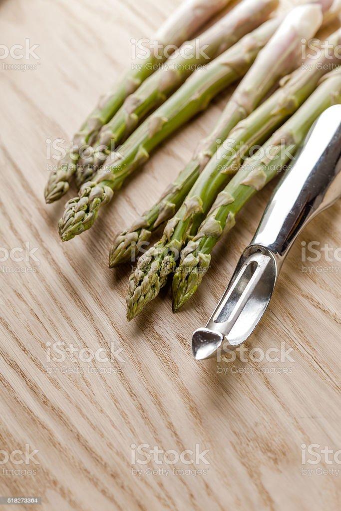 Bunch of asparagus and metal peeler stock photo