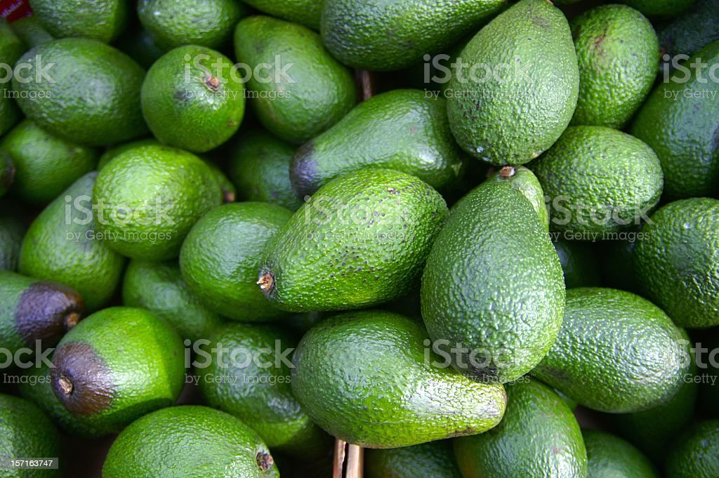 A bunch of avocados in baskets royalty-free stock photo