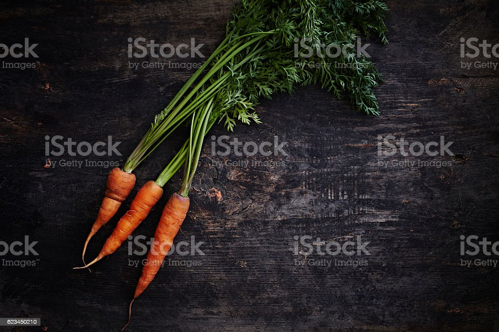 Bunch of baby carrots stock photo