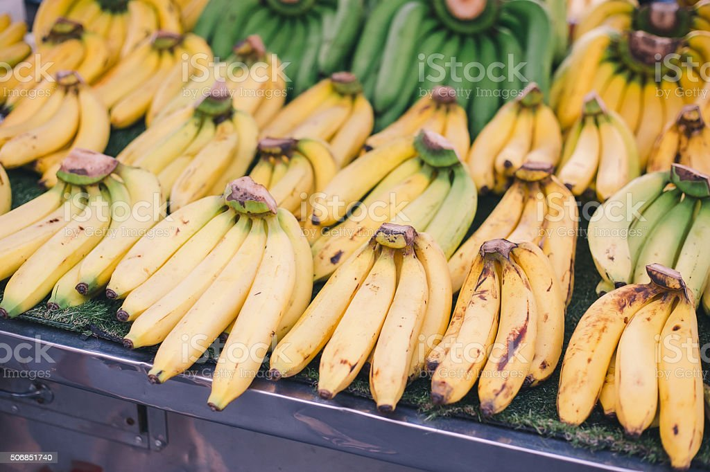 Bunch of bananas on a stand stock photo