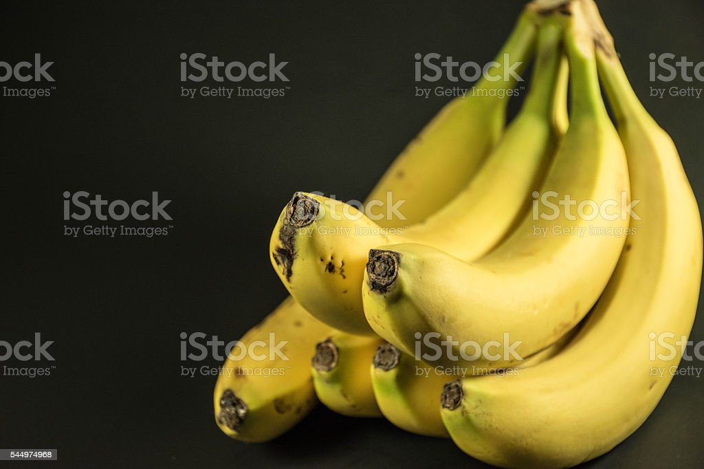 Bunch of bananas on black background stock photo