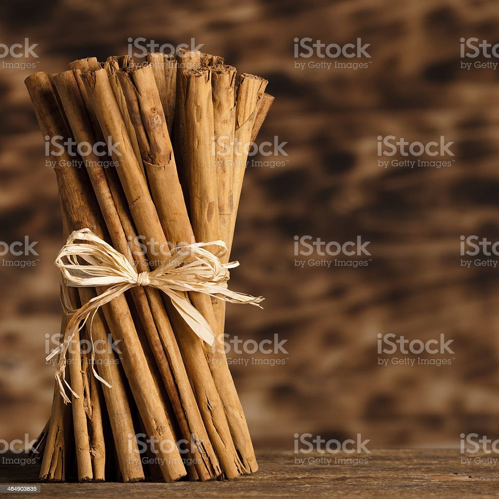 A bunch of Ceylon cinnamon tied together with a bow stock photo