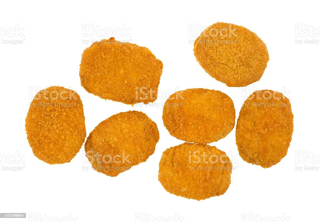 A bunch of chicken nuggets on a white background stock photo