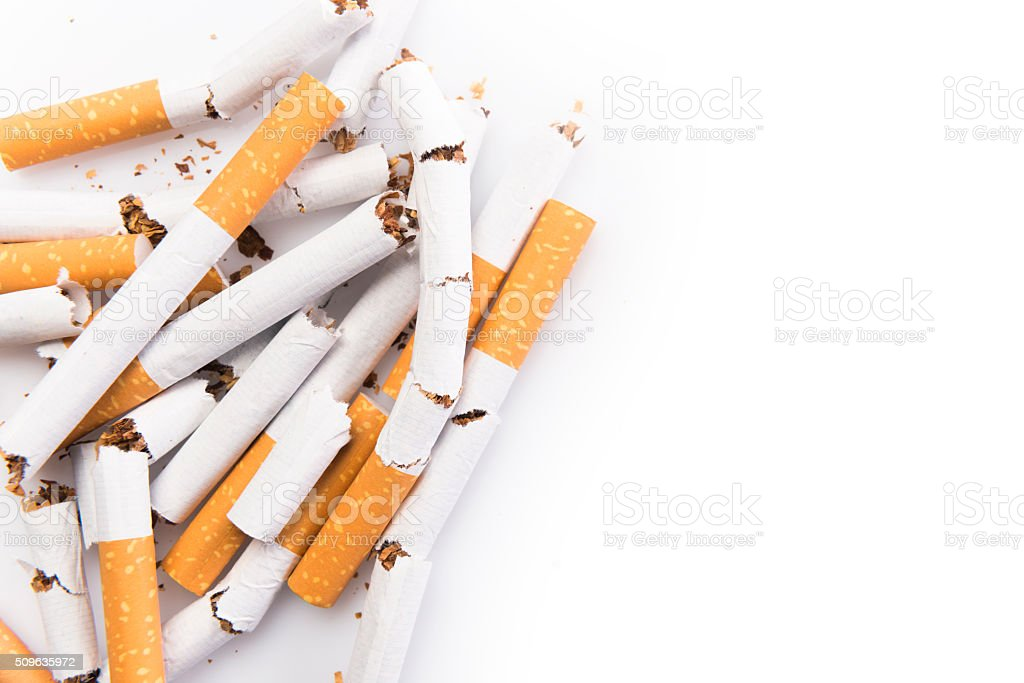 Bunch of cigarettes isolated on white stock photo