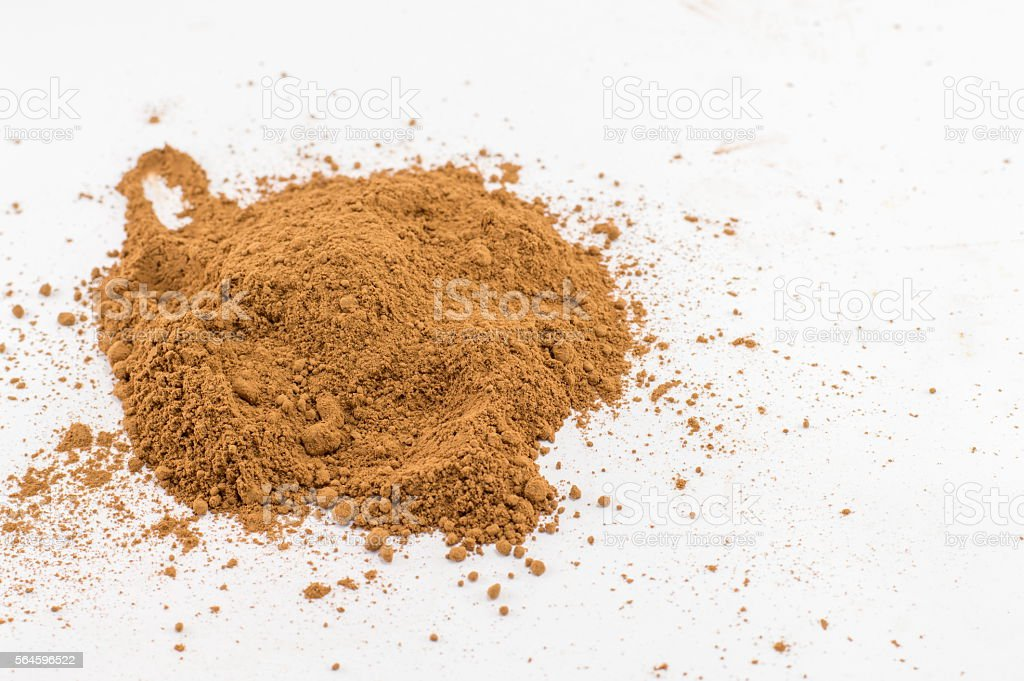 Bunch of cinnamon on white kitchen table stock photo