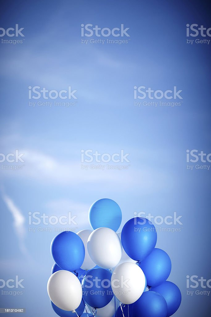 Bunch of colorful balloons in blue sky stock photo