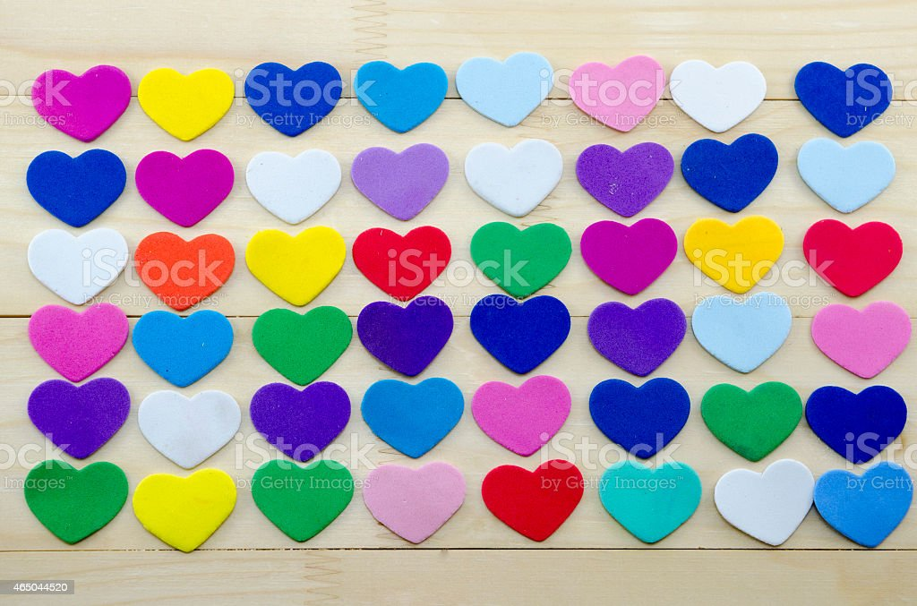 Bunch of colorful hearts on a table royalty-free stock photo