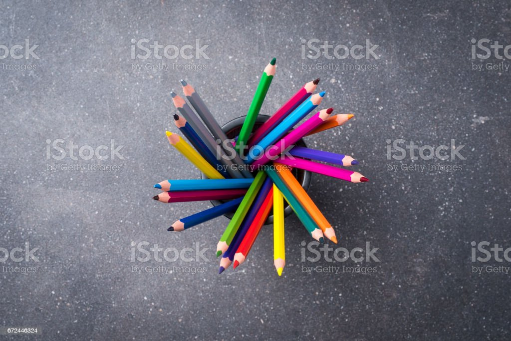 Bunch of colorful pencils on gray stone background stock photo