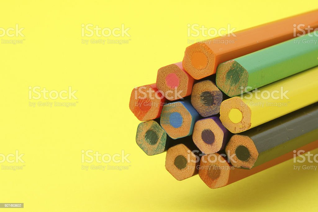 bunch of colorful pencils on yellow background royalty-free stock photo