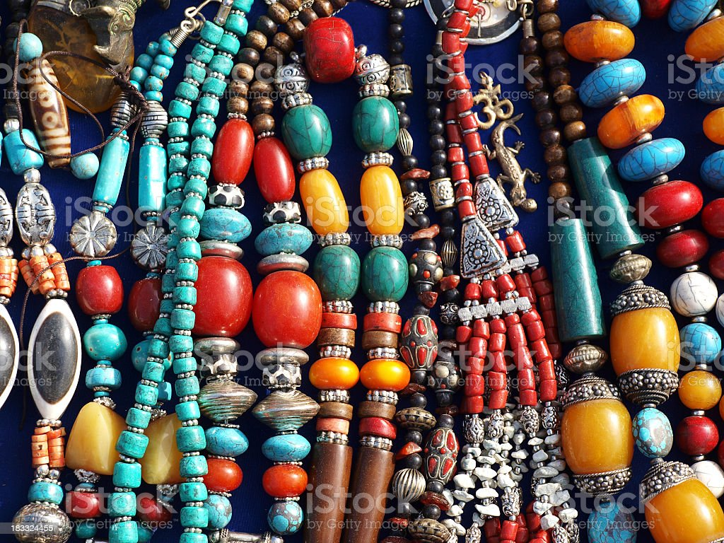 A bunch of colorful street jewelry on a table stock photo