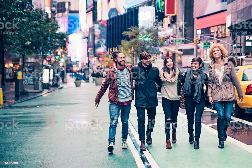 Bunch of cool young people walking in New-York after rain stock photo