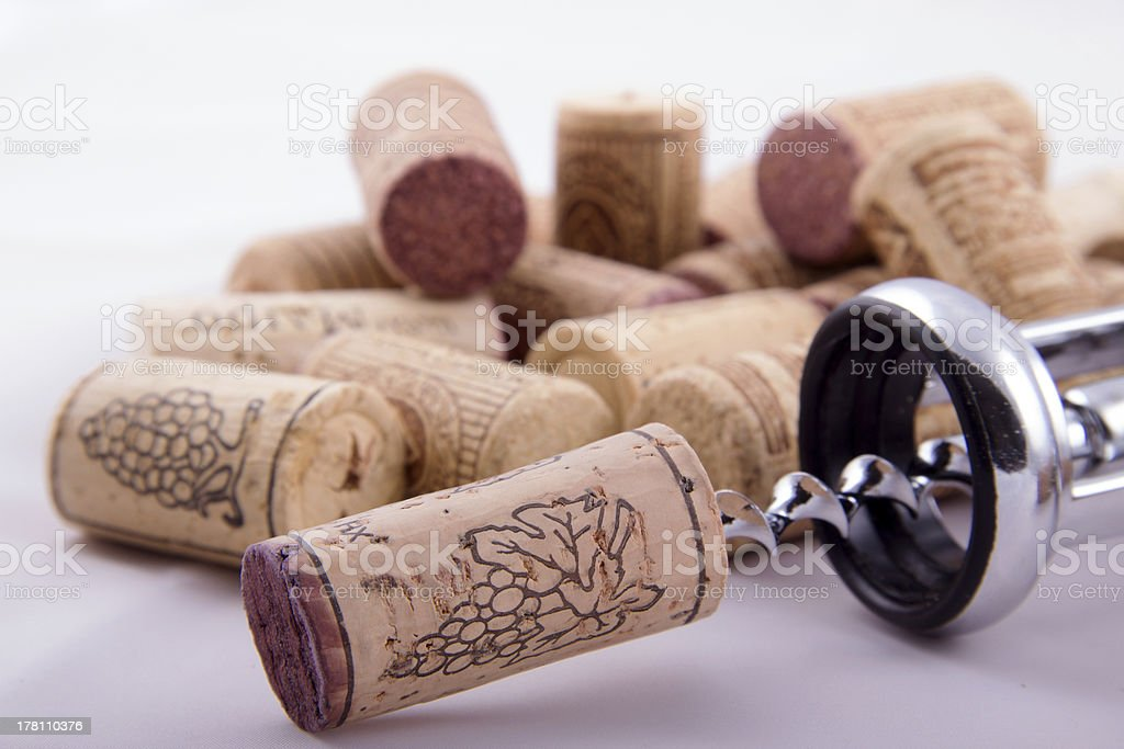 Bunch of corks and corkscrew royalty-free stock photo