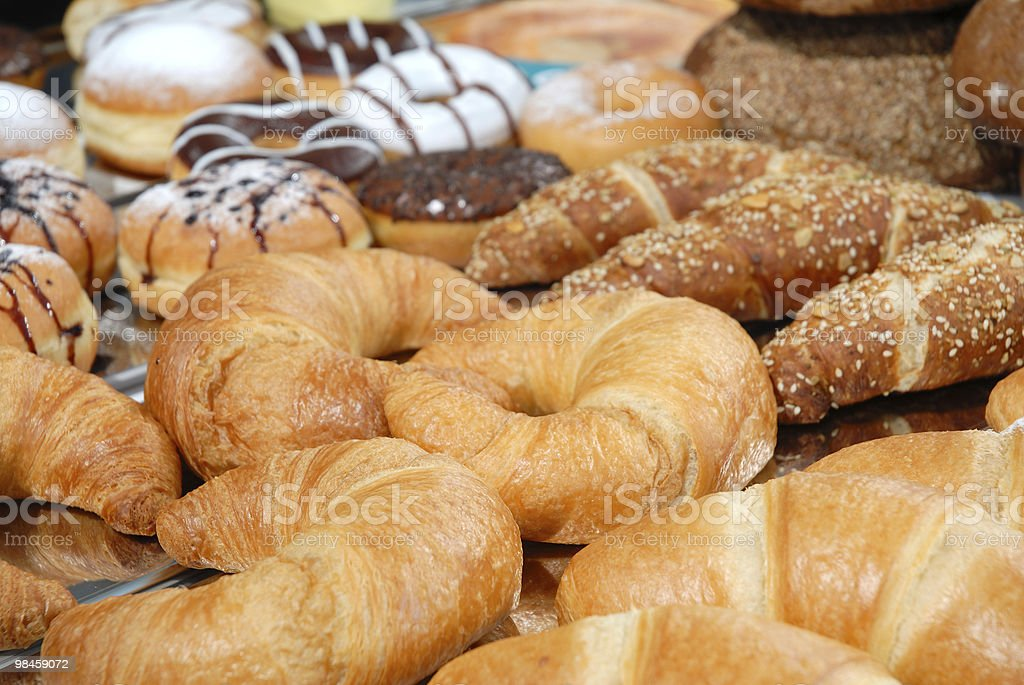 A bunch of croissants and other pastries stock photo