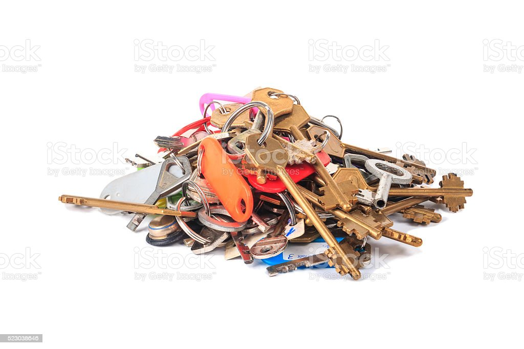 Bunch of different keys with labels on a white background stock photo