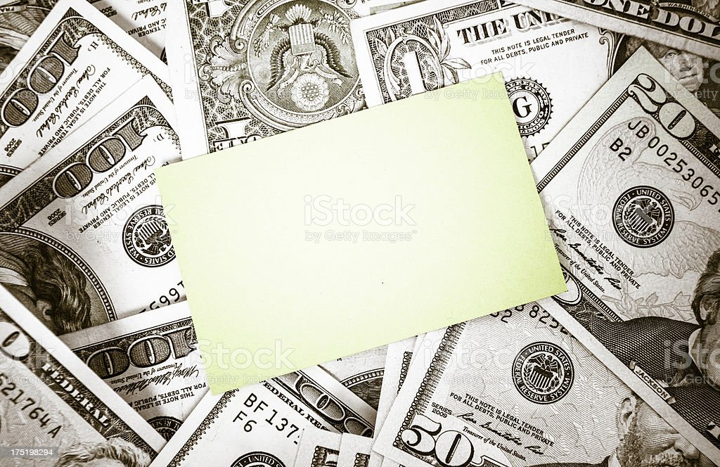Bunch of dollars with business card royalty-free stock photo
