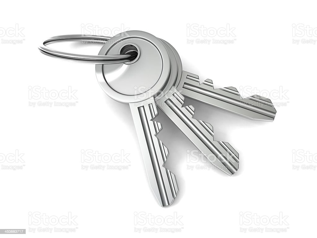 bunch of door keys on white background stock photo