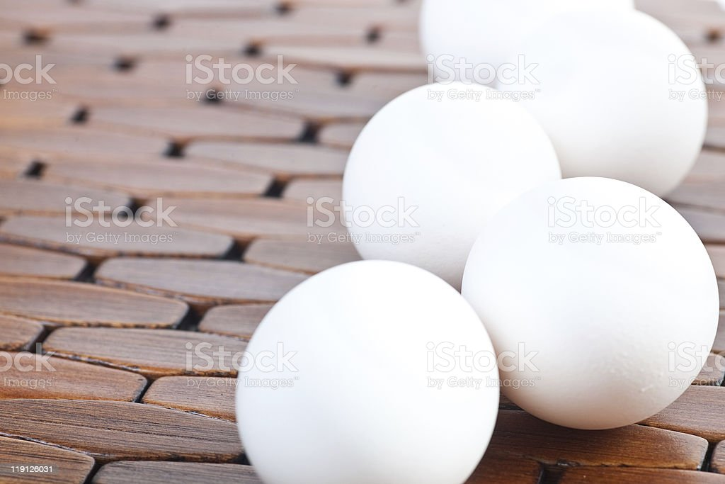 Bunch of eggs on wooden placemat royalty-free stock photo