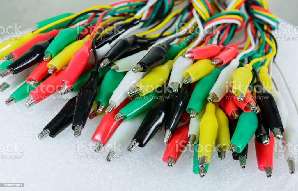 Bunch of electric crocodile plugs on white background electricity concept. stock photo
