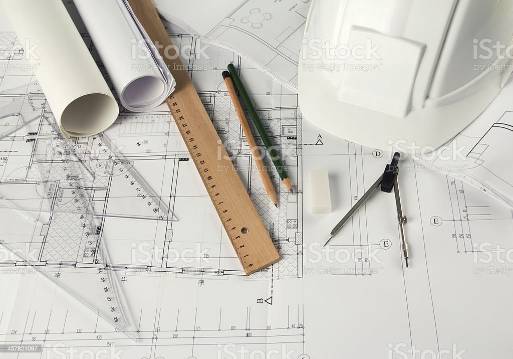 A bunch of engineering tools sprawled out on a blueprint stock photo