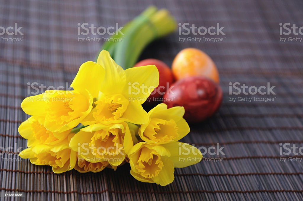 bunch of flower with yellow daffodil and easter eggs royalty-free stock photo