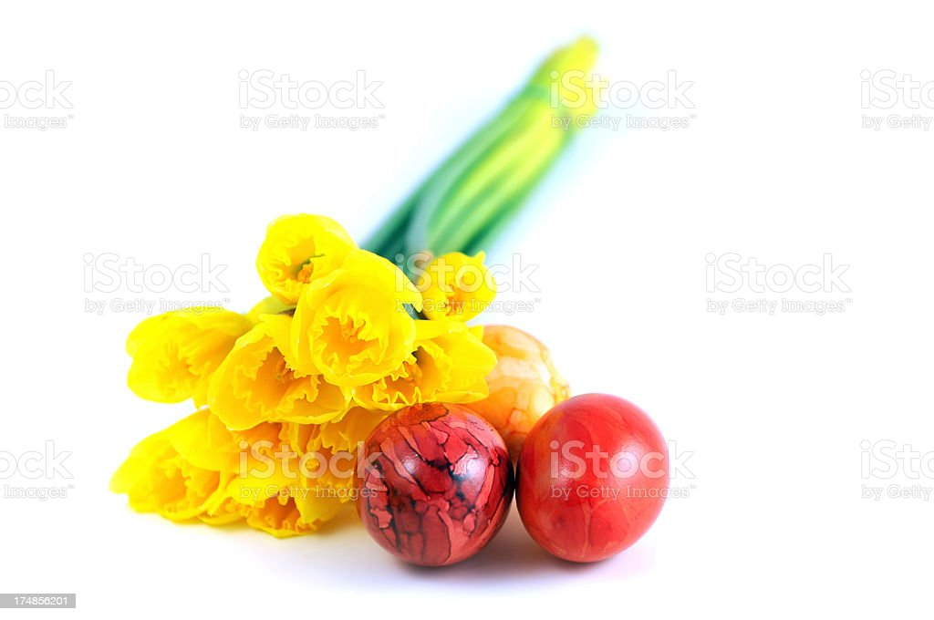 bunch of flower with yellow daffodil and easter eggs stock photo