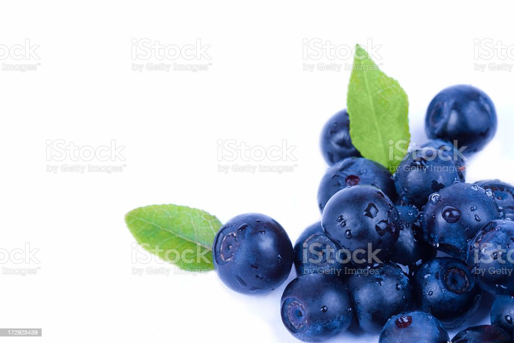 A bunch of fresh blueberries on a white surface  royalty-free stock photo
